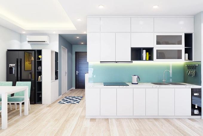 Nội thất của căn hộ được tối giản và sử dụng màu xanh bạc hà mát mắt.